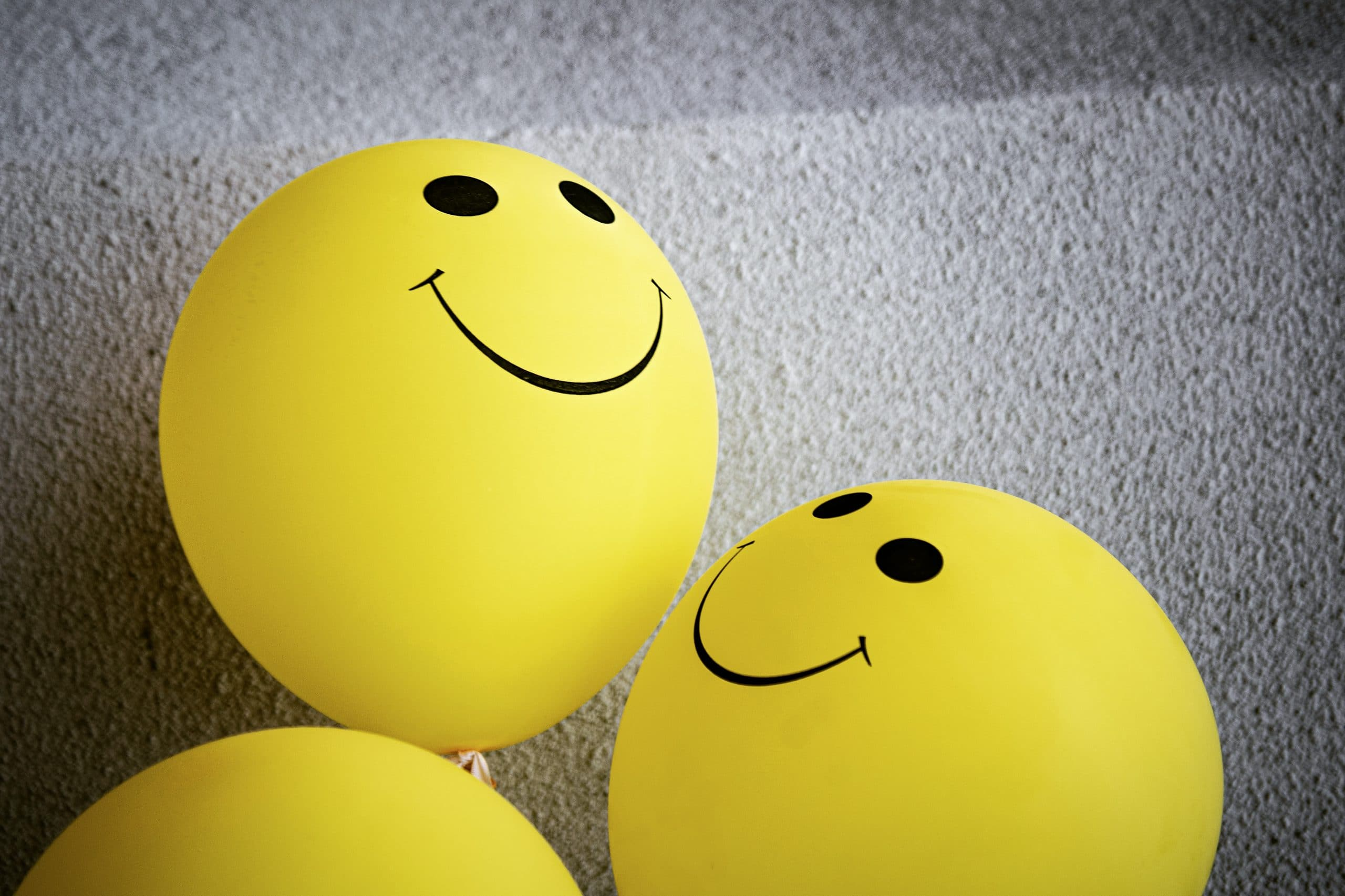 Smiling balloons signifying contact centers in the mental health space