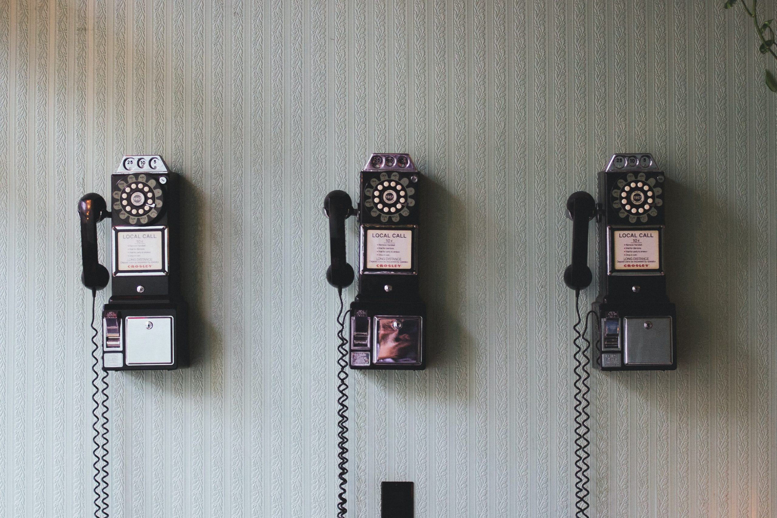 A row of pay phones symbolizes the many communication channels in omnichannel contact centers